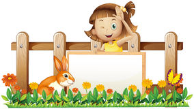 A girl holding an empty framed banner with a rabbit near the woo. Illustration of a girl holding an empty framed banner with a rabbit near the wooden fence  on a Royalty Free Stock Image