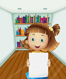 A girl holding an empty paper inside the room Stock Images