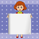 A girl holding an empty signage with a polkadot background Royalty Free Stock Photo