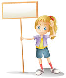 A girl holding an empty signboard Stock Photos