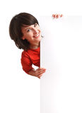 Girl holding an empty white board. Smiling beautiful girl holding an empty white board Stock Images
