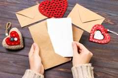 Girl holding an envelope with valentine hearts. Valentine day concept with copyspace Royalty Free Stock Photography