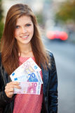 Girl holding 80 euro Stock Photos