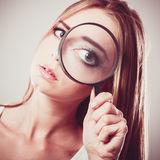Girl holding on eye magnifying glass loupe Stock Photo