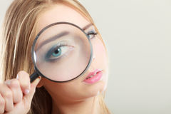 Girl holding on eye magnifying glass loupe Royalty Free Stock Images
