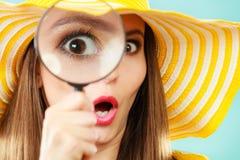 Girl holding on eye magnifying glass loupe Stock Photography