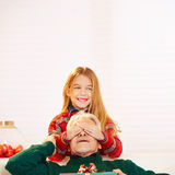 Girl holding eyes of grandfather closed Royalty Free Stock Images
