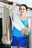 Girl holding fabric for vertical blind slats royalty free stock images