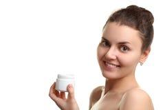 A girl holding a face cream stock photos