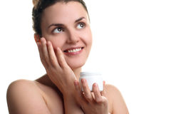 A girl holding a face cream Royalty Free Stock Photography