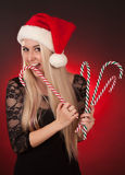 Girl holding fake candy cane Stock Image