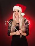 Girl holding fake candy cane Royalty Free Stock Photos