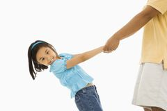 Girl holding father's hands. Royalty Free Stock Image