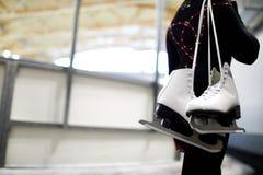 Girl Holding Figure Skates royalty free stock photography