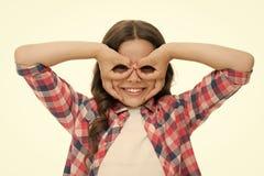 Girl holding fingers near eyes like glasses mask superhero or owl. Play game with mask superhero. Child cheerful mood stock image