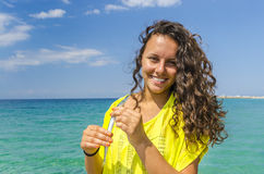 Girl holding a fish Royalty Free Stock Image