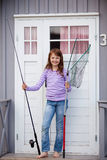 Girl Holding Fishing Net And Rod At Camping House Royalty Free Stock Photography