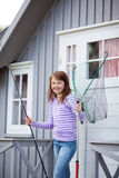 Girl Holding Fishing Net And Rod Stock Image