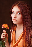 Girl holding a flower Royalty Free Stock Photos
