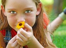Girl Holding Flower Stock Image