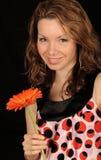 Girl holding flower Royalty Free Stock Images