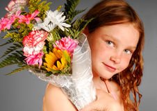 Girl Holding Flower Bouquet Stock Photo