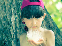 Girl holding flower Royalty Free Stock Photography