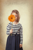 Girl holding a flower Stock Photography