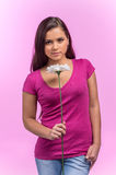 Girl holding flower on pink background. Stock Photography