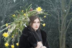 Girl holding a flower umbrella in garden royalty free stock photos