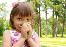 Girl holding flowers. In the park Stock Image