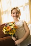 Girl holding flowers. Stock Photos