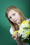 Girl holding flowers Stock Photography