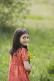 Girl Holding Flowers In Field Royalty Free Stock Photos