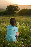 Girl Holding Flowers In Field At Sunset Royalty Free Stock Photography