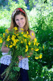 Girl holding flowers Stock Images
