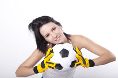 Girl holding a football. Girl holding a football and smiling Stock Images