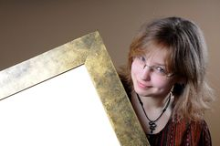 Girl holding frame Royalty Free Stock Images
