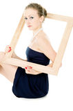 The girl is holding the frame from picture Royalty Free Stock Photos