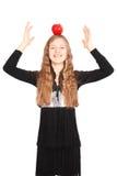 Girl holding fresh apple Stock Image