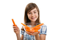 Girl holding fresh carrots Royalty Free Stock Photos