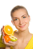 Girl holding fresh fruits Royalty Free Stock Photos