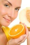 Girl holding fresh fruits Stock Image