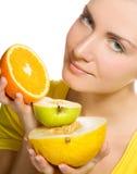 Girl holding fresh fruits Stock Photography