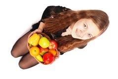 Girl holding fresh fruits Royalty Free Stock Photography