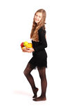 Girl holding fresh fruits Royalty Free Stock Images