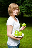 Girl holding fresh green apples Stock Photo