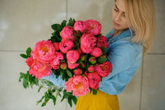 Girl holding fresh pink peony flower Royalty Free Stock Photo