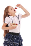 Girl holding fresh sweet cherries Stock Image