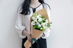 Girl holding white flower bouquet. Girl holding fresh white flower bouquet Royalty Free Stock Photography